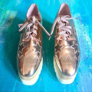 Via Pinky Metallic Rose Gold Lace Up Platforms